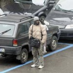 Un parcheggiatore abusivo